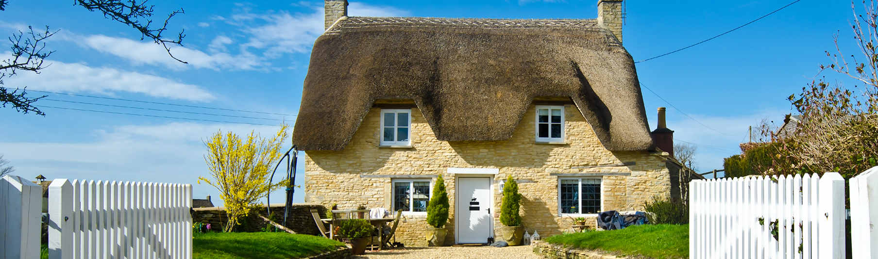 Household Insurance: A picturesque yellow cottage in the countryside