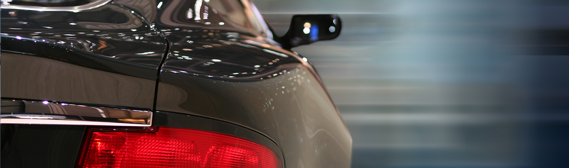 Motor Insurance: Close-up of the back side of a dark grey car