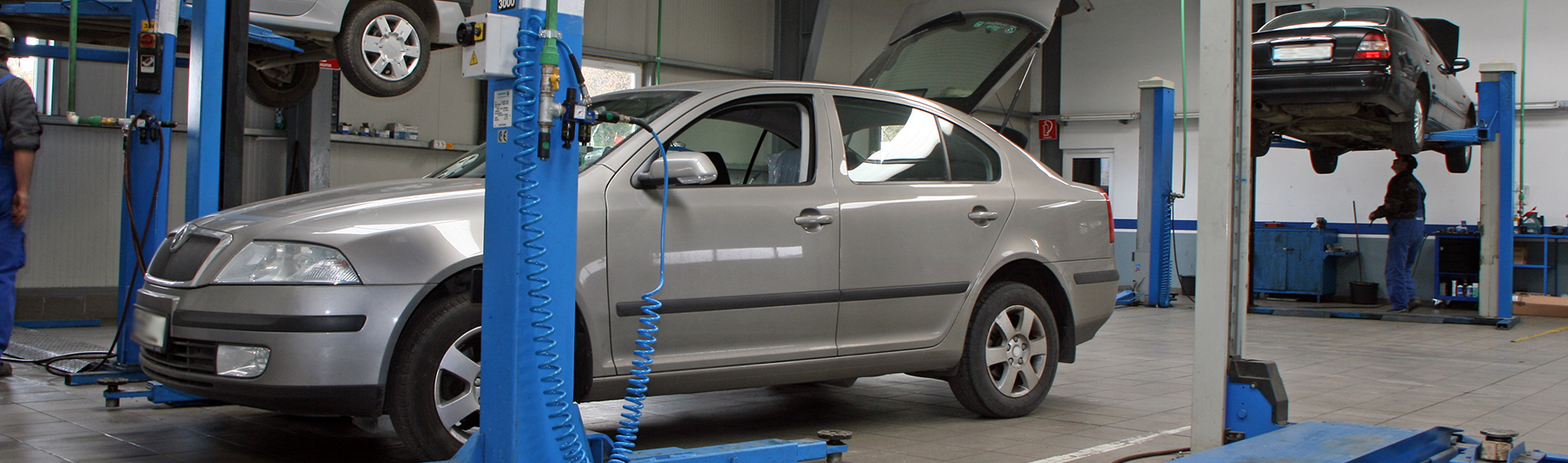 Motor Trade Insurance: A grey car inside a motor workshop