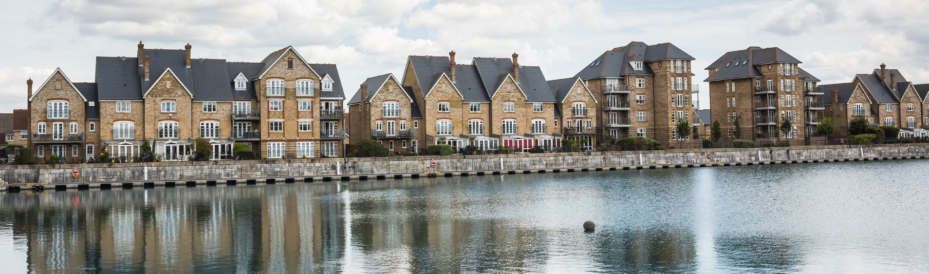 Property Insurance: Terraced houses and their reflection in the river opposite